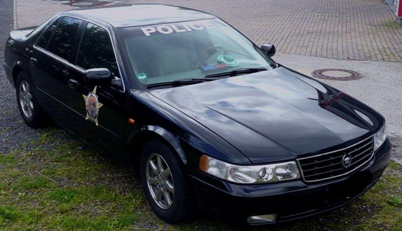 firstclass-limusine-police-cadillac